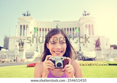 Rome tourist taking photo pictures on retro camera. Woman on travel in Italy in front of Altare della Patria, Monumento Nazionale a Vittorio Emanuele II also called il Vittoriano. Rome, Italy tourism. - stock photo