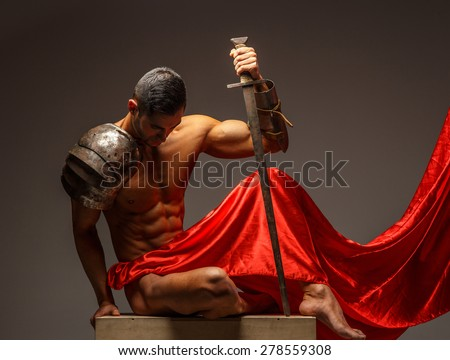Rome warrior sitting on podium and looking down. Isolated on grey background - stock photo