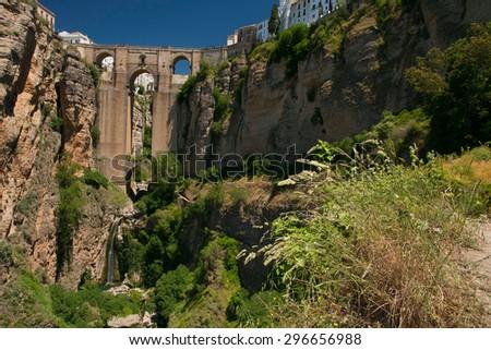 Ronda new bridge; horizontal shot from west (Andalusia, Spain) - stock photo