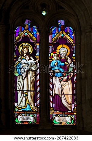 RONDA, SPAIN - DECEMBER 1, 2013: Stained Glass depicting Mother Mary and Saint Joseph, Jesus' parents, in the Church of Ronda, Spain