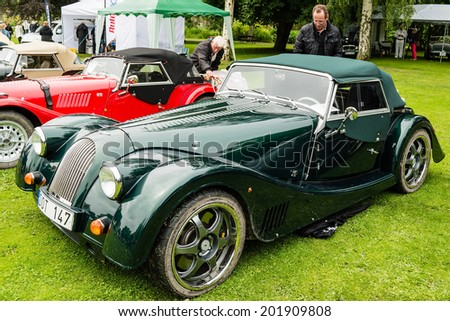 RONNEBY, SWEDEN - JUNE 28, 2014: Nostalgia Festival, classic cars, motorcycles and fashion. Green Morgan.