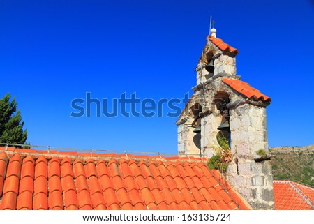Roof and bells of orthodox monastery near the Adriatic sea - stock photo