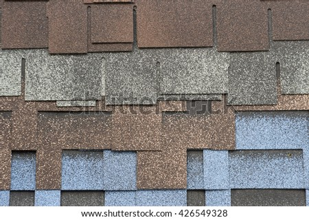 roof bitumen shingles closeup background texture colored - stock photo