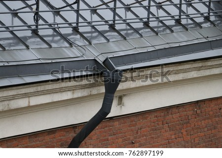 Roof drain pipe with water pipe heat cable & Roof Drain Pipe Water Pipe Heat Stock Photo (Royalty Free) 762897199 ...