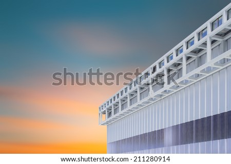 Roof gutter of factory with sky background. - stock photo