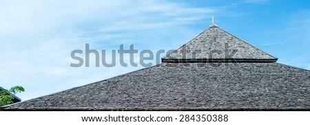 roof in garden against blue sky. - stock photo