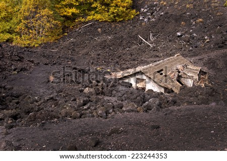 Roof of a house covered by lava of Etna volcano, Sicily, Italy