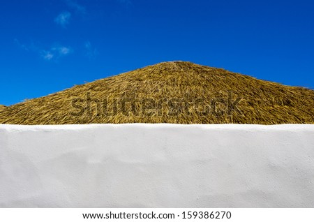 Roof of a small pacific island hut against blu sky  in Rarotonga Cook Islands. - stock photo