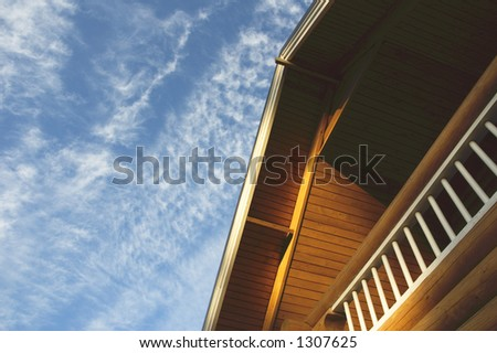 roof of country house over blue sky