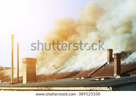 Roof on fire - stock photo