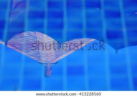 Roof resort swimming pool with sunny reflections - stock photo