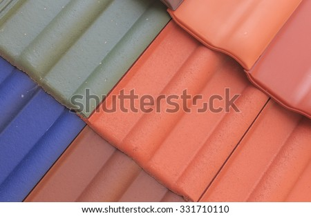 roof shingles. flexible texture tiles for roofing/colored flexible texture tile roof house closeup - stock photo