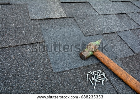 Roof Shingles   Roofing. Asphalt Shingles On A Roof With Hammer And Nails.  Close