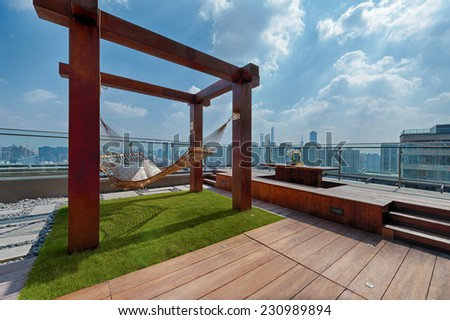Roof terrace with hammock on a sunny day in Shanghai - stock photo