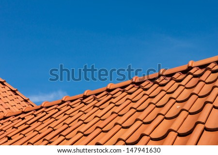 roof tile pattern over blue sky - stock photo