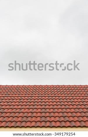 Roof tile pattern over sky background - stock photo