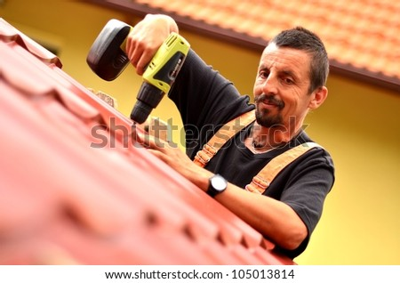 roof tiler - stock photo