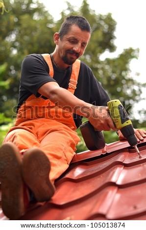 roof tiler - stock photo