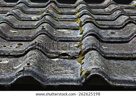 roof tiles covering the old medieval texture - stock photo