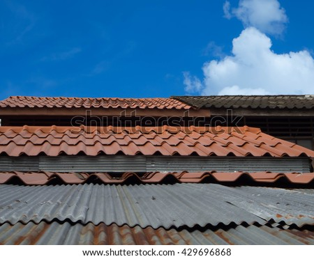 Roof Tiles Rusted Tin Roof Texture And Background With Bright Blue Sky And  White Cloud