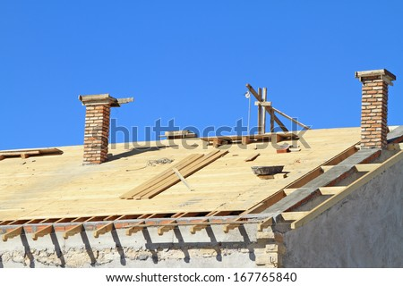 Roof under construction. Carpentry work - stock photo