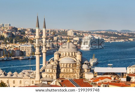 roof Valide Khan and Yeni Cami (The New Mosque) in Istanbul, Turkey - stock photo