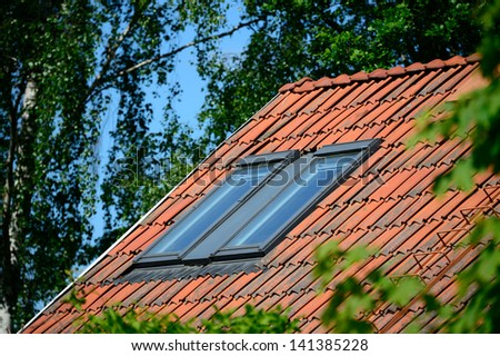 Roof windows and green garden - stock photo