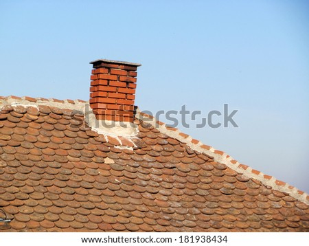 Roof with chimney - stock photo