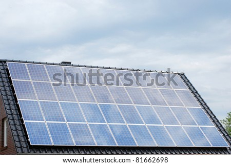 Roof with photovoltaic - stock photo