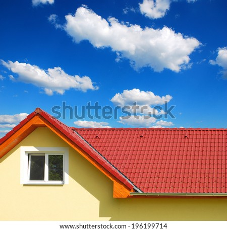roof with red tiles on a background of blue sky, new roof - stock photo