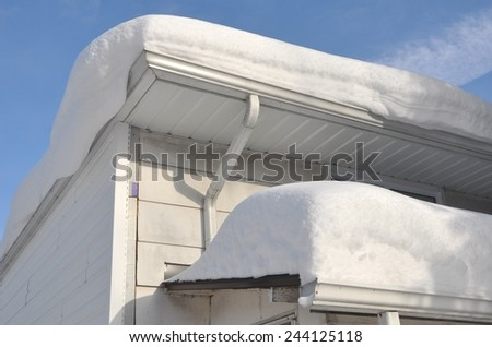 Roof with snow - stock photo