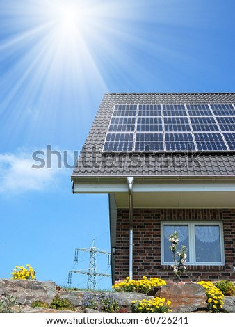 Roof with solar panel under cloudy sky