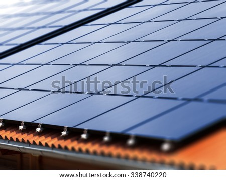 Roof with solar panels - stock photo