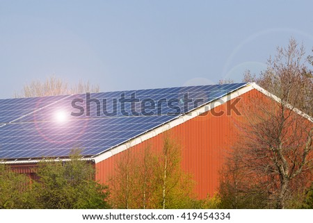 roof with solar panels and lens flare - stock photo