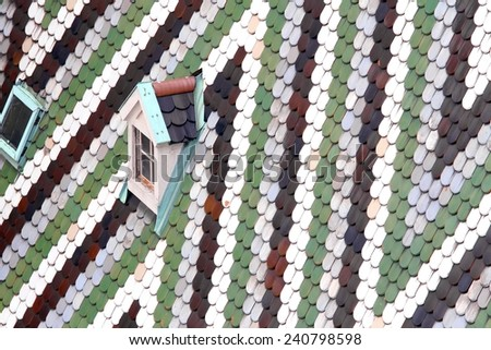 Roof with tiles in majolica and ceramics of the Cathedral of St. Stephen in the Centre of Vienna in austria - stock photo