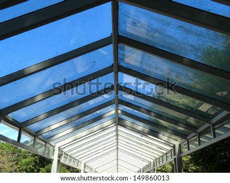 Roofed pathway with reflections