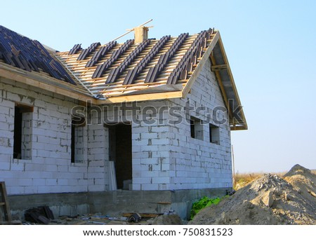 Roofing Construction With Clay Roof Tiles. Building House With Ceramic Roof  Tiles.