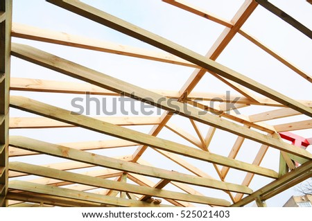 Roofing Construction. Wooden Roof Frame House Construction. Installation Of  Wooden Beams At Construction The
