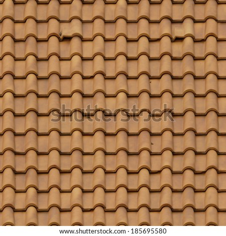 Roofing made of new, light brown shingles with rounded surfaces. - stock photo