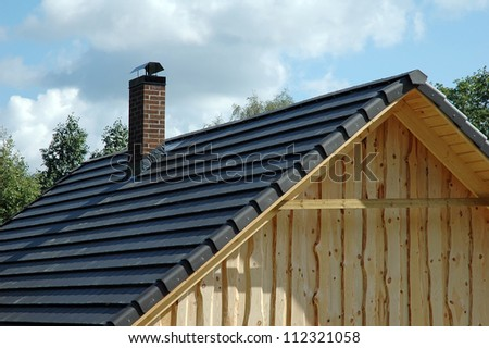roofing tiles on roof - stock photo