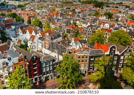 Roofs and facades of Amsterdam. City view from the bell tower of the church Westerkerk, Holland, Netherlands. - stock photo