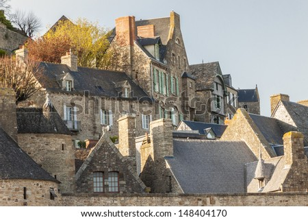 Roofs and houses from the village under the monastry on the Mountain Saint Michel. - stock photo