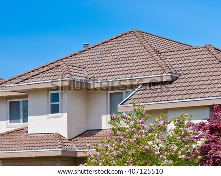 Roofs and windows of a modern house in great neighborhood, in suburbs of Vancouver, Canada. - stock photo
