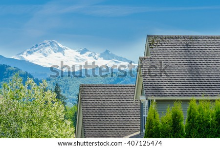 Roofs of a modern houses in great neighborhood, in suburbs of Vancouver, Canada. - stock photo