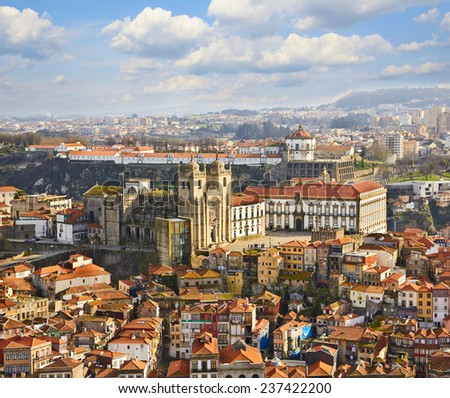 Roofs of old city and The Porto Cathedral in Porto, Portugal - stock photo