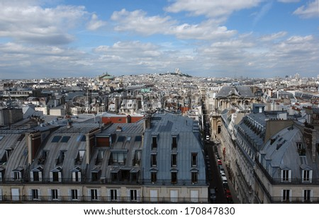 Roofs of Paris and montmartre hill