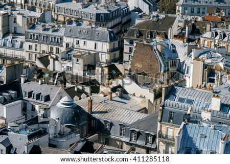 Roofs of Paris photographed from the tower of Notre-Dame cathedral. This image is toned. - stock photo