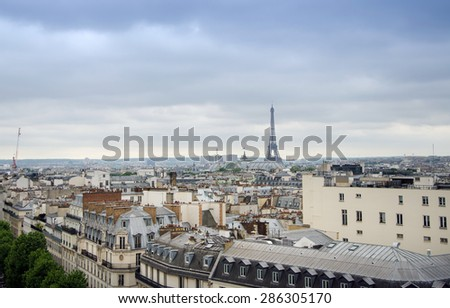 Roofs of Paris with Eiffel Tower in background, France. - stock photo
