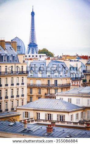 Roofs of paris, with eifiel tower in the background - stock photo