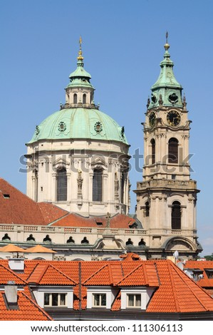 Roofs of the old Prague (Czech Republic) and the St. Nicholas church cupola and bell tower.